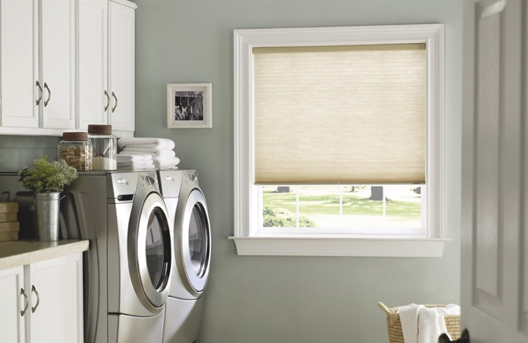 Southern California laundry room with beige window shades.